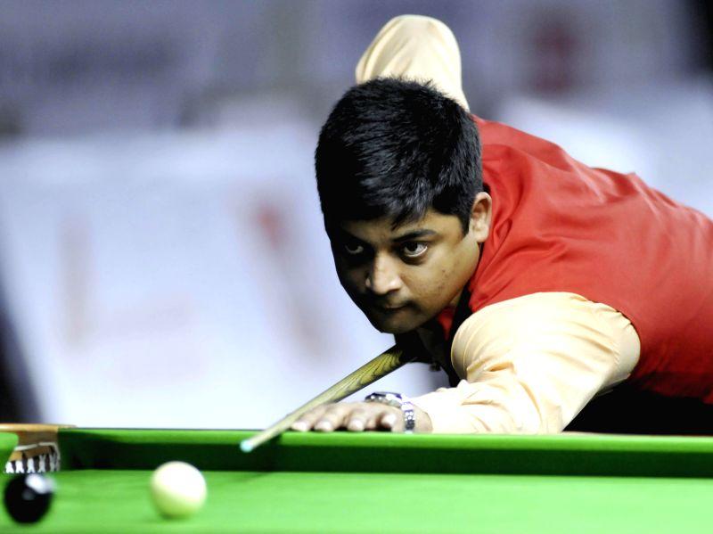 Indian player Brijesh Damani in action during IBSF World Snooker Championships at Kanteerava Stadium, in Bengaluru on Nov. 26, 2014.