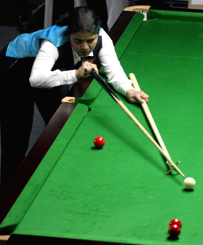 Indian player Chitra Magimairaj in action during IBSF World Snooker Championships at Kanteerava Stadium, in Bengaluru on Nov. 21, 2014.