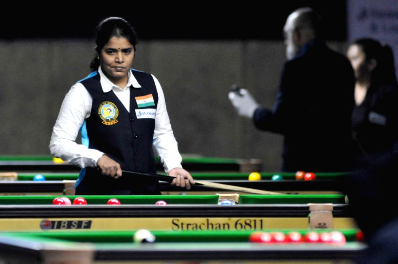 Indian player Chitra Magimarajani in action during IBSF World Snooker Championships at Kanteerava Stadium, in Bengaluru on Nov. 22, 2014.