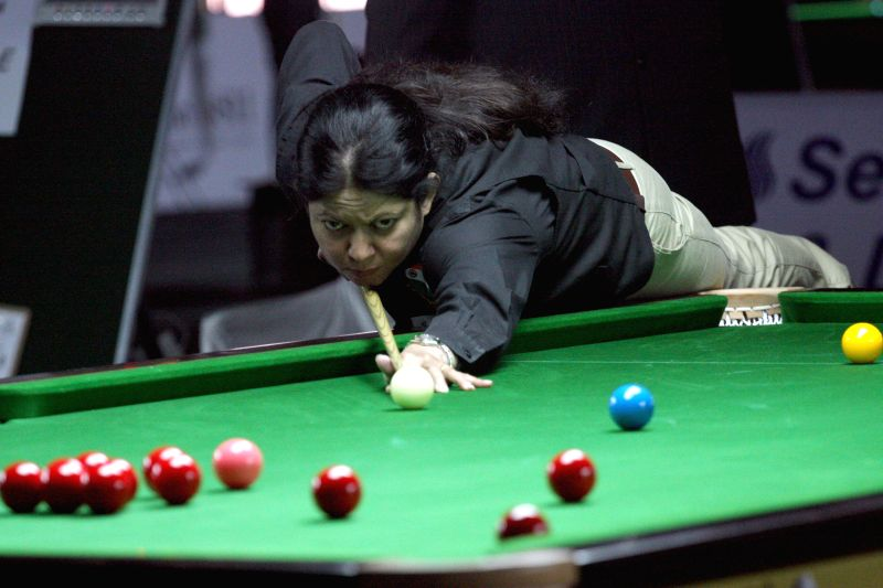 Indian player Judy Walia in action during IBSF World Snooker Championships at Kanteerava Stadium, in Bengaluru on Nov. 27, 2014.