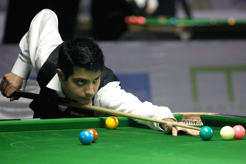 Indian player Kamal Chawla in action during IBSF World Snooker Championships at Kanteerava Stadium, in Bengaluru on Nov. 20,  2014.