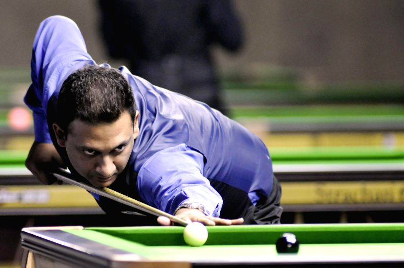 Indian player Manan Chandra in action during IBSF World Snooker Championships at Kanteerava Stadium, in Bengaluru on Nov. 26, 2014.