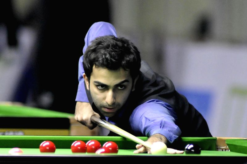 Indian player Pankaj Advani during a game of IBSF World Snooker Championship at Kanteerava Stadium, in Bengaluru on Nov. 25, 2014.