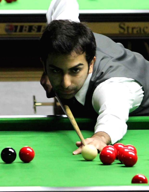 Indian player Pankaj Advani in action during IBSF World Snooker Championships at Kanteerava Stadium, in Bengaluru on Nov. 28, 2014.