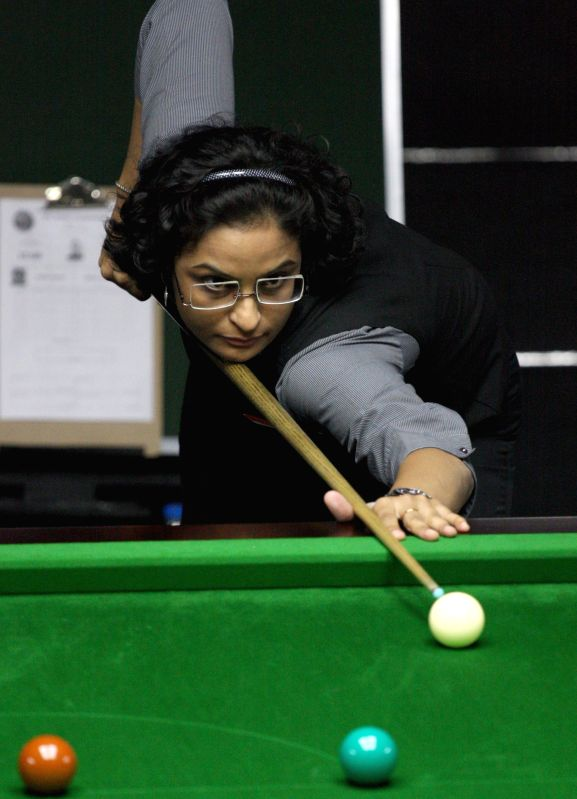 Indian player Suniti Damani in action during IBSF World Snooker Championships at Kanteerava Stadium, in Bengaluru on Nov. 21, 2014.