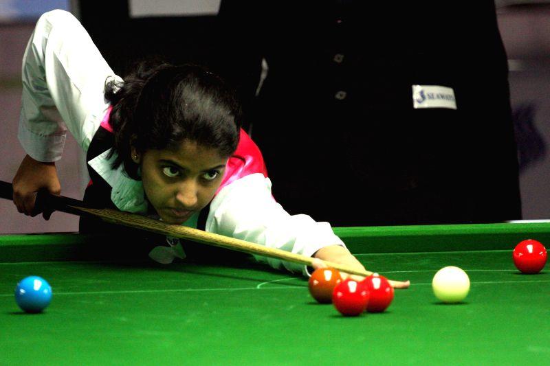 Indian player Varsha Sanjeev in action during IBSF World Snooker Championships at Kanteerava Stadium, in Bengaluru on Nov. 27, 2014.
