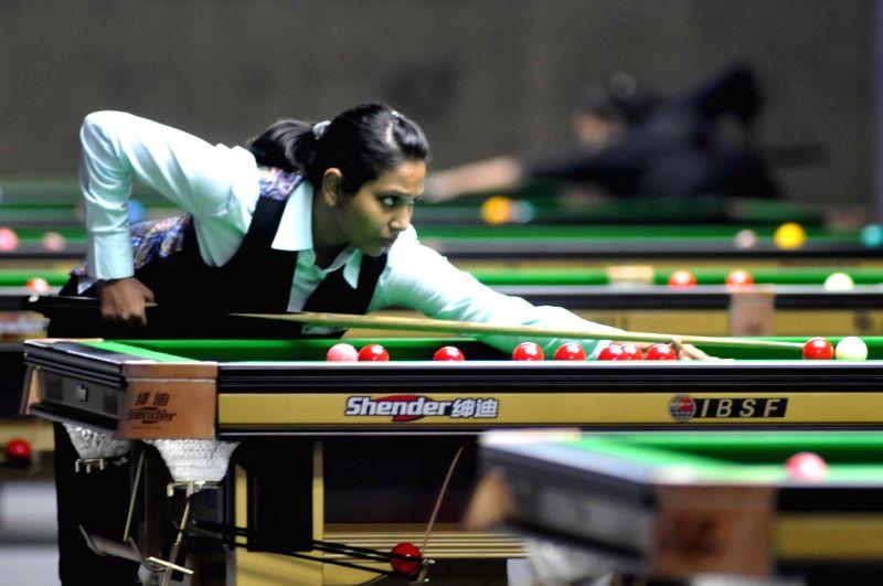 Indian player Vidhya Pillai in action during IBSF World Snooker Championships at Kanteerava Stadium, in Bengaluru on Nov. 22, 2014.