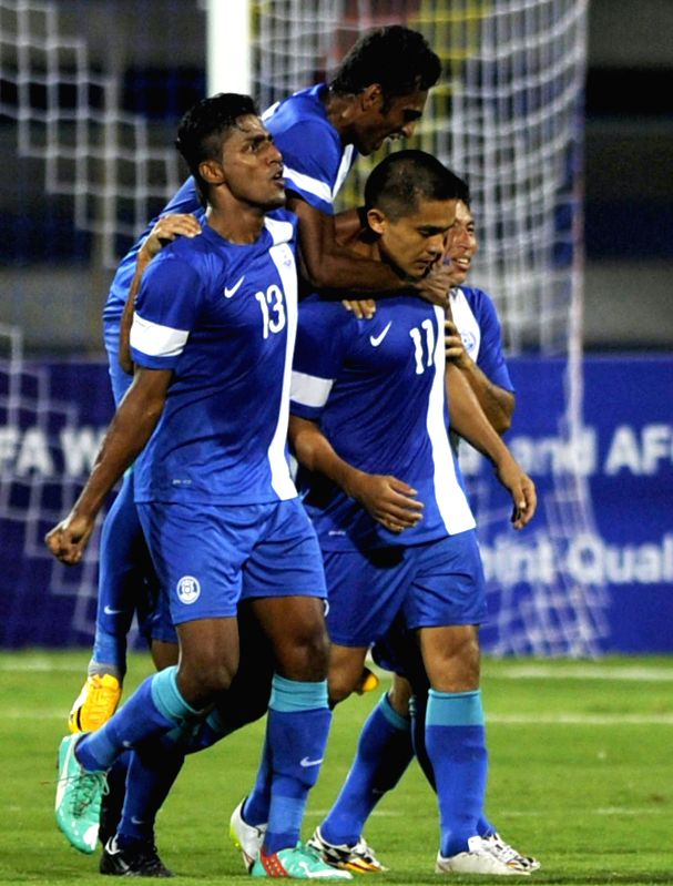 Indian players celebrates after Sunil Chetri scores a goal during India vs Oman FIFA world cup 2018 qualifying match at Kanteerava Stadium, in Bengaluru on June 11, 2015. India lose 1-2.