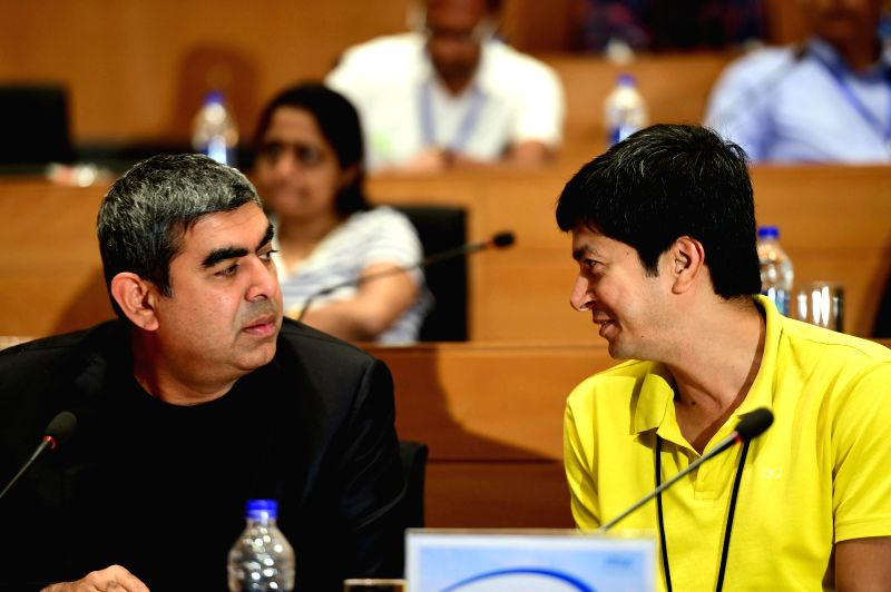 Infosys  CEO and MD Vishal Sikka and CFO if the company Rajiv Bansal during a press conference in Bengaluru, on Jan 9, 2015.