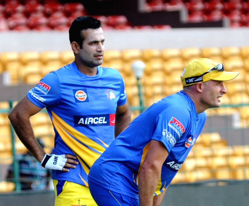 Irfan Pathan and Michael Hussey of Chennai Super Kings during a practice session at M Chinnaswamy Stadium in Bengaluru on April 21, 2015.