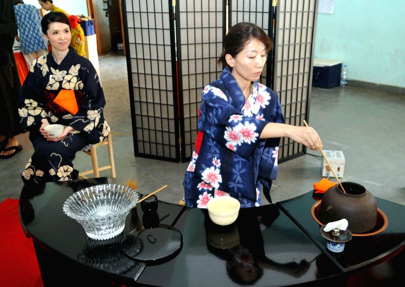 Japanese women cook their traditional food during `Japan Habba – 2015` - an Indo-Japan cultural exchange programme at Jana Bharati Auditorium in Bengaluru on Feb 15, 2015.