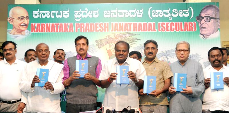 JD(S) supremo HD Deve Gowda with party leaders H D Kumarswamy, Y S V Datta and others during the release of JD(S) party 2015 dairy at JD(S) party office, in Bengaluru, on Dec 27, 2014.