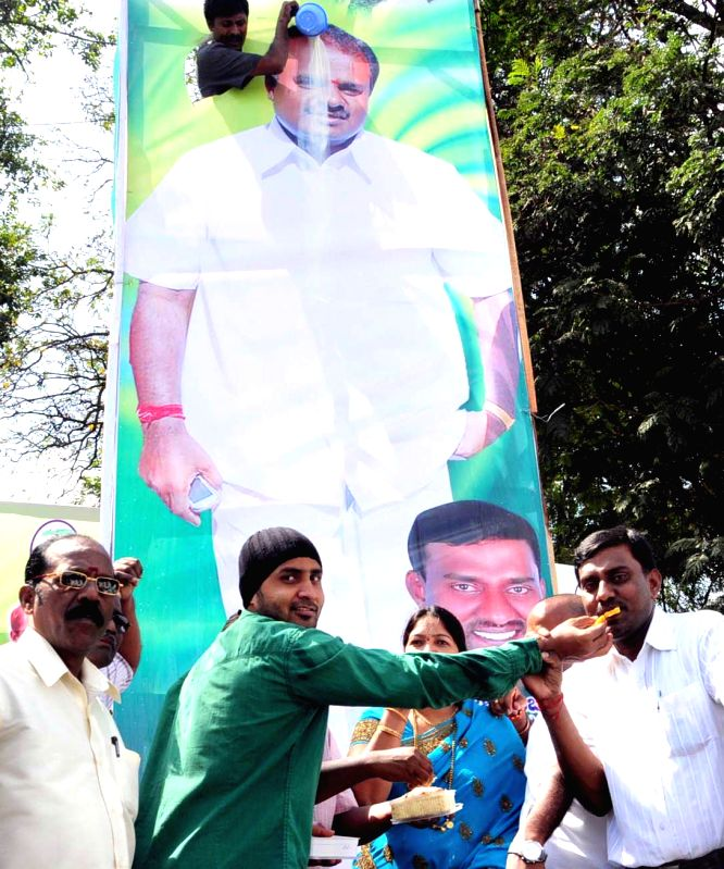 JD(S) workers celebrate party leader H D Kumaraswamy's birthday at JD(S) office in Bengaluru, on Dec 16, 2014.