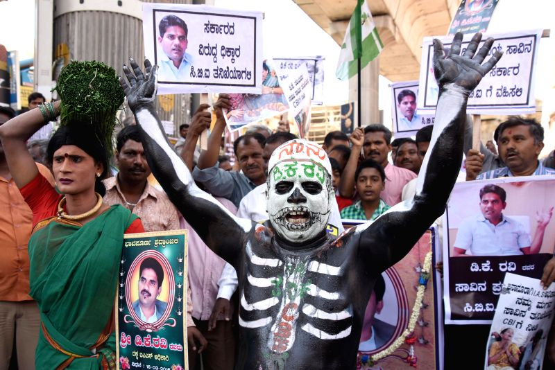 JD(S) workers stage a demonstration to demand CBI probe in the mysterious death of Karnataka IAS D K Ravi in Bengaluru on March 20, 2015.