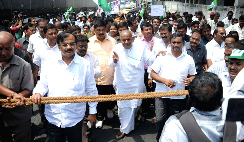 JDS supremo HD Deve Gowda leads a demonstration against splitting of BBMP in Bengaluru, on April 9, 2015.