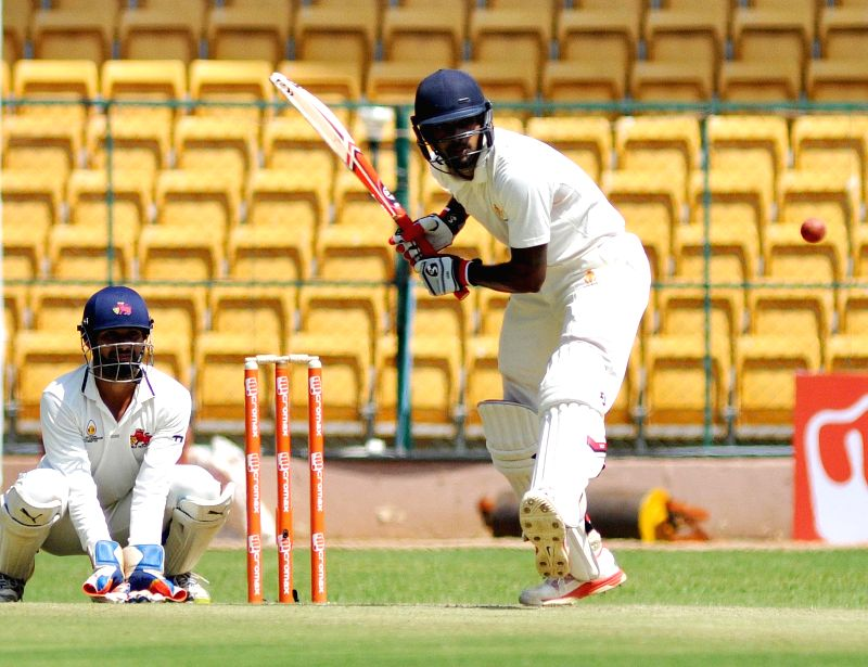 Karnataka batsmen Abhimanyu Mithun in action during a Ranji Trophy Semi Final match between Karnataka and Mumbai at M Chinnaswamy Stadium, in Bengaluru on Feb 26, 2015.