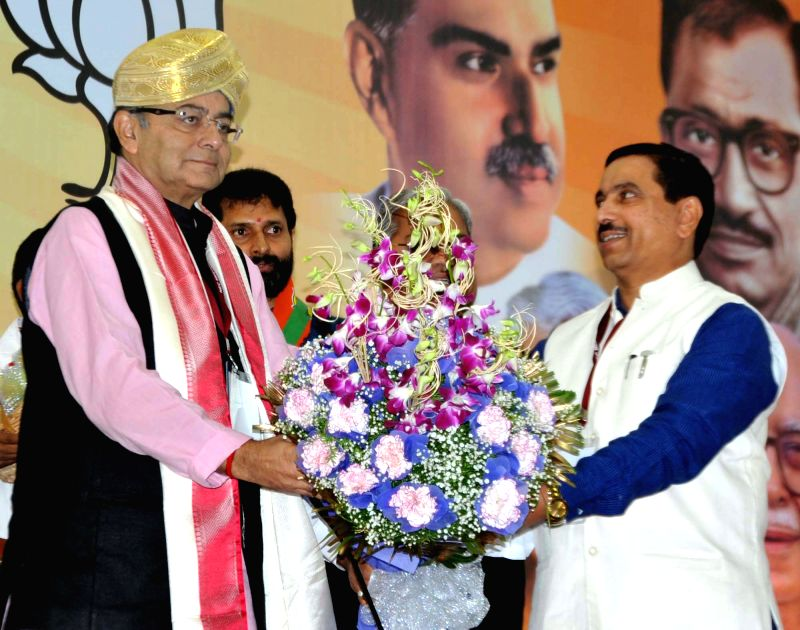 Karnataka BJP chief Prahalad Joshi felicitates Union Minister for Finance, Corporate Affairs, and Information and Broadcasting Arun Jaitley during party's National Executive Committee ... - Prahalad Joshi and Arun Jaitley