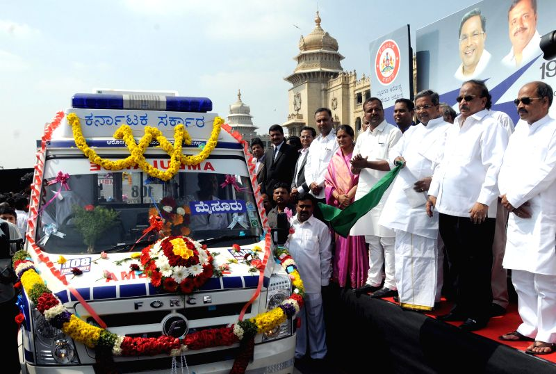 Karnataka Chief Minister Siddaramaiah, and others flag-off 198 Aarogya Kavacha Ambulances at Vidhana Soudha, in Bengaluru on Nov. 25, 2014. - Siddaramaiah