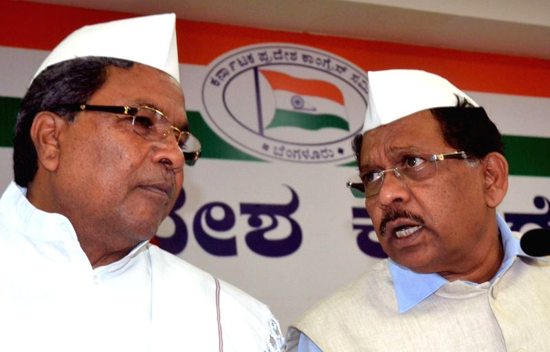 Karnataka Chief Minister Siddaramaiah with Karnataka Congress chief G Parameshwar during a programme organised to celebrate the foundation day of Congress in Bengaluru, on Dec 28, 2014. - Siddaramaiah