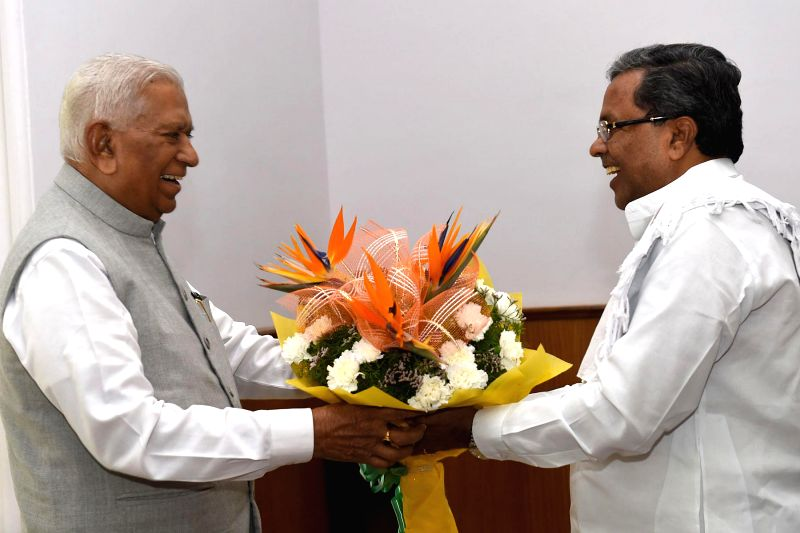 Karnataka Chief Minister Siddaramaiah calls on Karnataka Governor Vajubhai Rudabhai Vala to wish him on new year at Raj Bhavan in Bengaluru, on Jan 2, 2015. - Siddaramaiah