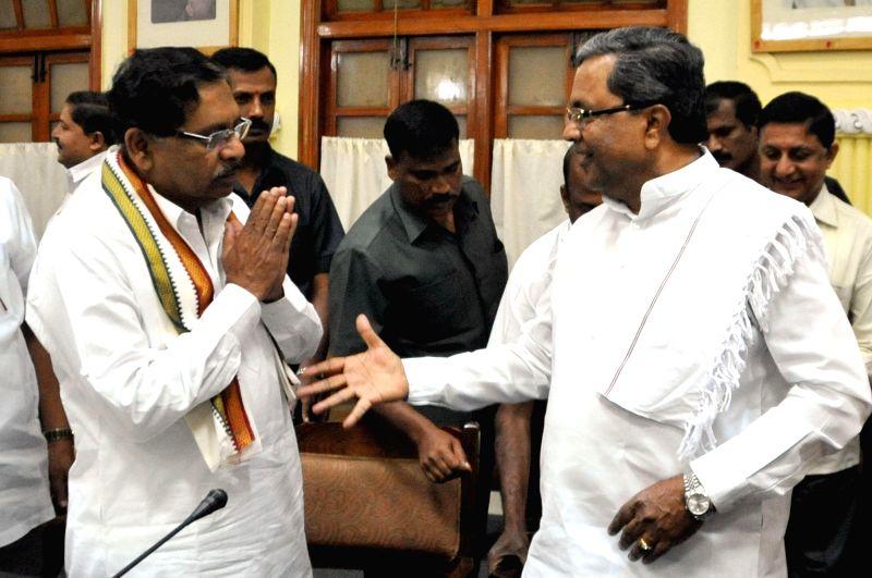 Karnataka Chief Minister Siddaramaiah, Karnataka Congress chief G Parmeshwar during a  Congress Legislative Party meeting at Vidhana Soudha in Bengaluru, on Jan 2, 2015. - Siddaramaiah