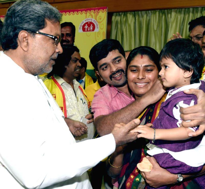 Karnataka Chief Minister Siddaramaiah launches National Pulse Polio Immunization programme  in Bengaluru, on Jan 18, 2015. - Siddaramaiah