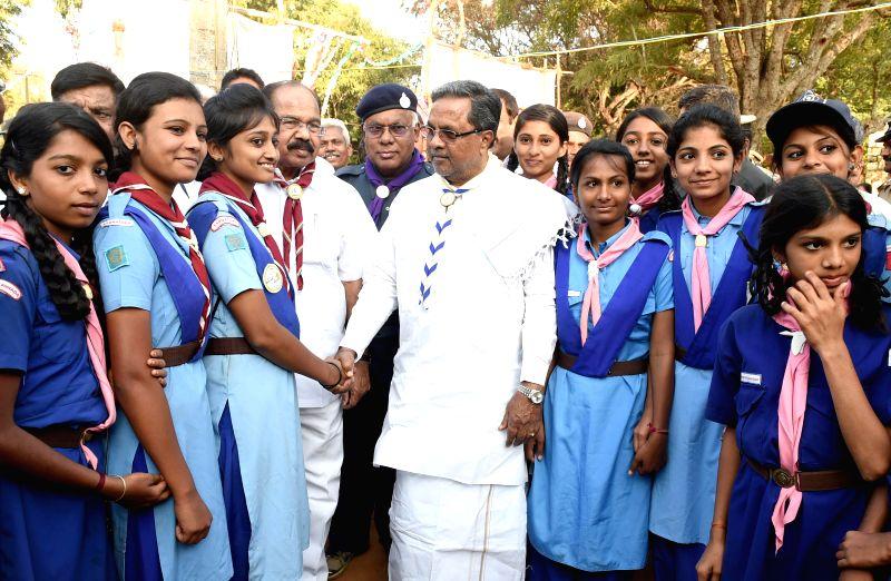 Karnataka Chief Minister Siddaramaiah interacts with Guides at the 27th Karnataka State Scouts - Guides Jamborette in Bengaluru, on Jan 22, 2015. - Siddaramaiah