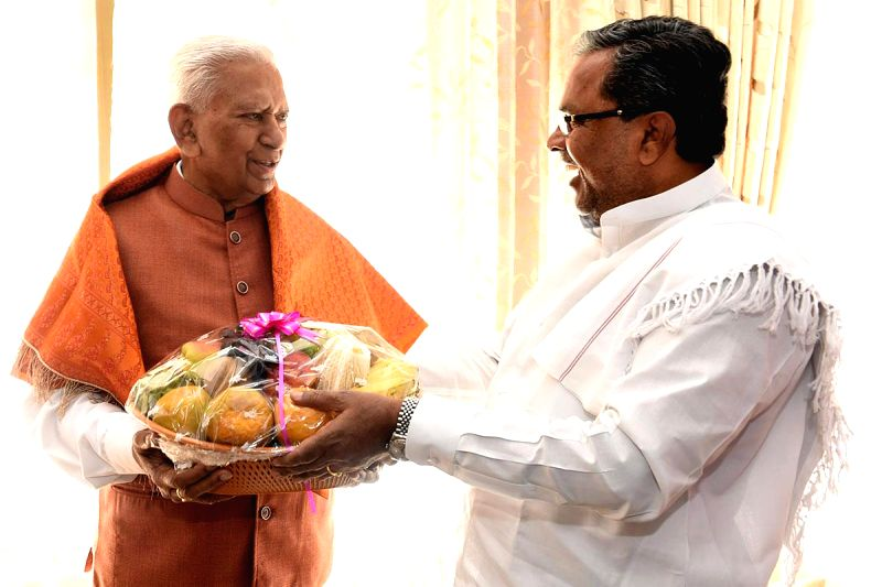 Karnataka Chief Minister Siddaramaiah greets Karnataka Governor Vajubhai Rudabhai Vala on his birthday at Raj Bhawan in Bengaluru, on Jan 23, 2015. - Siddaramaiah