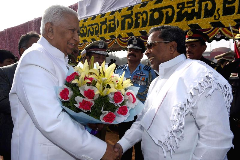 Karnataka Chief Minister Siddaramaiah greets Governor Vajubhai Rudabhai Vala on his arrival at the Manekshaw Parade Grounds for Republic Day celebrations in Bengaluru, on Jan 26, 2015. - Siddaramaiah