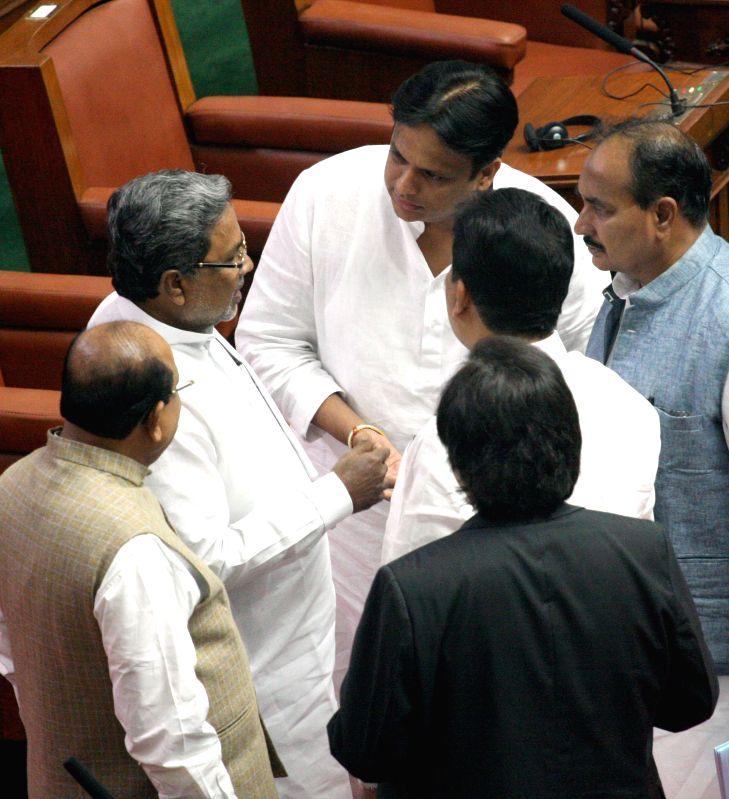 Karnataka Chief Minister Siddaramaiah interacts with legislators during a joint Karnataka Legislative Assembly at Vidhan Soudha, in Bengaluru on Feb. 2, 2015. - Siddaramaiah