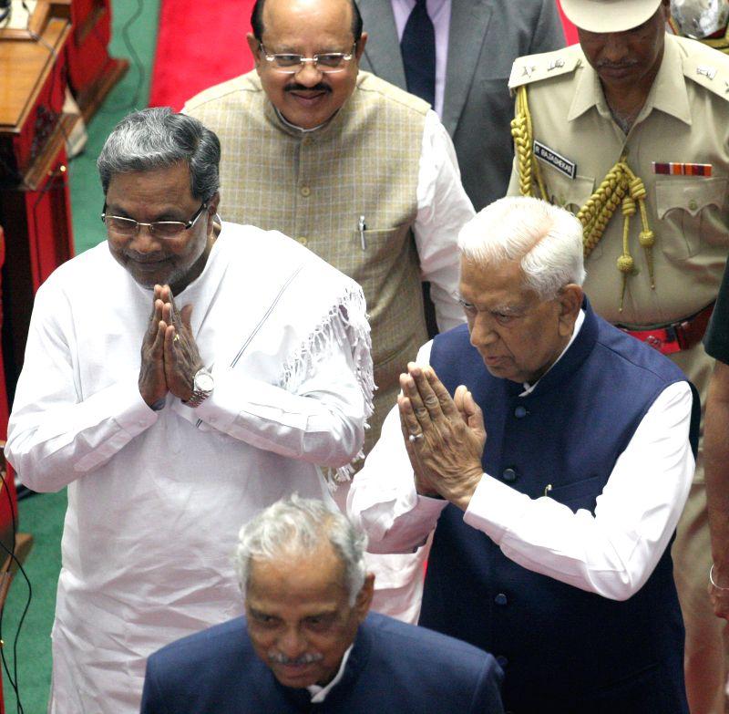 Karnataka Chief Minister Siddaramaiah, Karnataka Governor Vajubhai Rudabhai Vala, Assembly Speaker Kagodu Thimmappa and Council Chairman D H Shankarmurthy during a joint Karnataka ... - Siddaramaiah