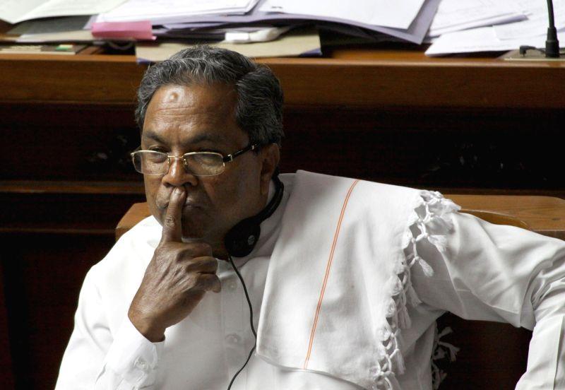 Karnataka Chief Minister Siddaramaiah addresses during a joint Karnataka Legislative Assembly at Vidhan Soudha, in Bengaluru on Feb. 3, 2015. - Siddaramaiah