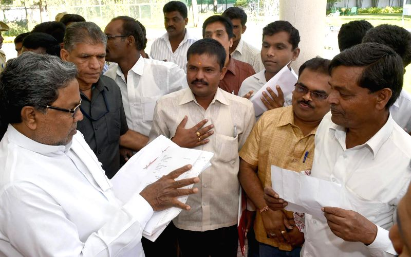 Karnataka Chief Minister Siddaramaiah interacts with public during `Janata Darshan` in Bengaluru, on Feb 6, 2015. - Siddaramaiah
