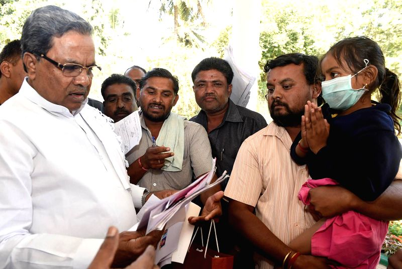 Karnataka Chief Minister Siddaramaiah interacts with public during `Janata Darshan` in Bengaluru, on Feb 7, 2015. - Siddaramaiah