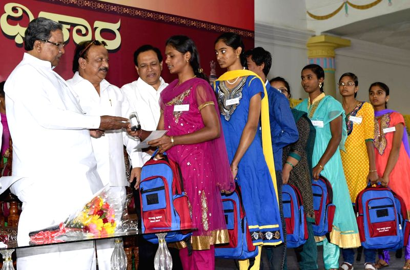 Karnataka Chief Minister Siddaramaiah during an award function organised by Kannada Development Authority to felicitate the students of Kannada language in Bengaluru, on Feb 7, 2015. - Siddaramaiah