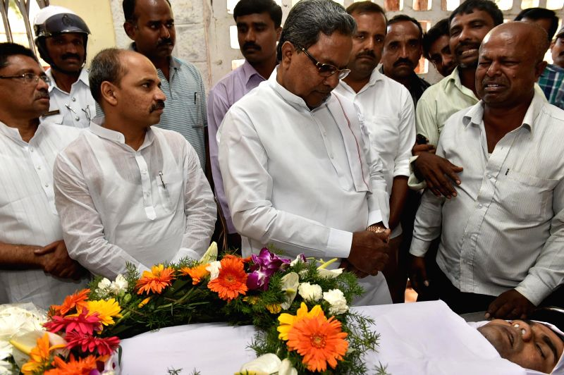 Karnataka Chief Minister Siddaramaiah pays tribute to Bangalore Additional Commissioner of Commercial Taxes D K Ravi, who was found dead in his apartment under mysterious circumstances in ... - Siddaramaiah