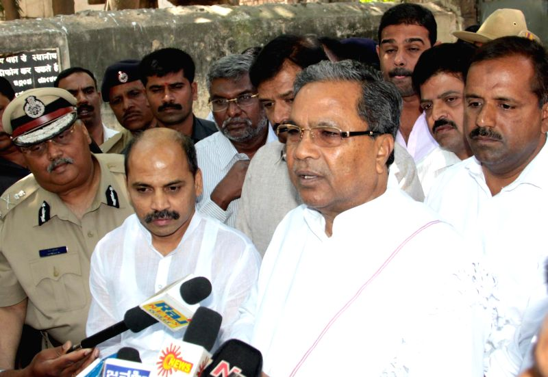 Karnataka Chief Minister Siddaramaiah talks to press during his visit to the Victoria Hospital to pay his last respects to Bangalore Additional Commissioner of Commercial Taxes D K Ravi, ... - Siddaramaiah
