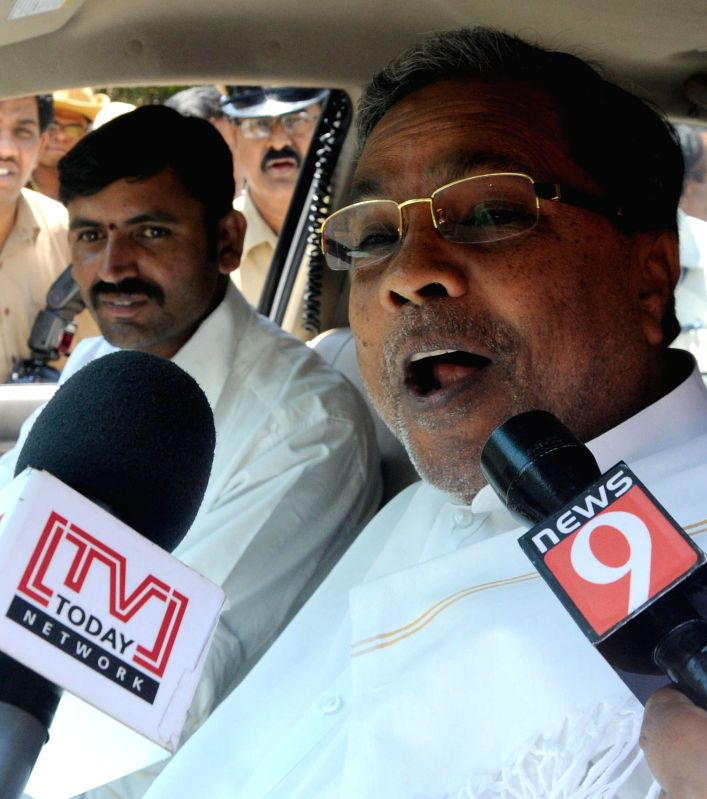 Karnataka Chief Minister Siddaramaiah talks to press after meeting Karnataka Governor Vajubhai Rudabhai Vala in Bengaluru, on March 20, 2015. - Siddaramaiah