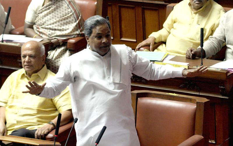 Karnataka Chief Minister Siddaramaiah addresses in the Karnataka assembly, in Bengaluru on March 23, 2015.