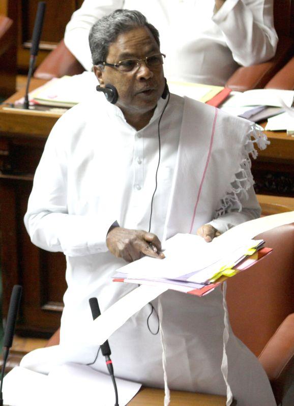 Karnataka Chief Minister Siddaramaiah addresses in the Karnataka assembly, in Bengaluru on March 24, 2015. - Siddaramaiah