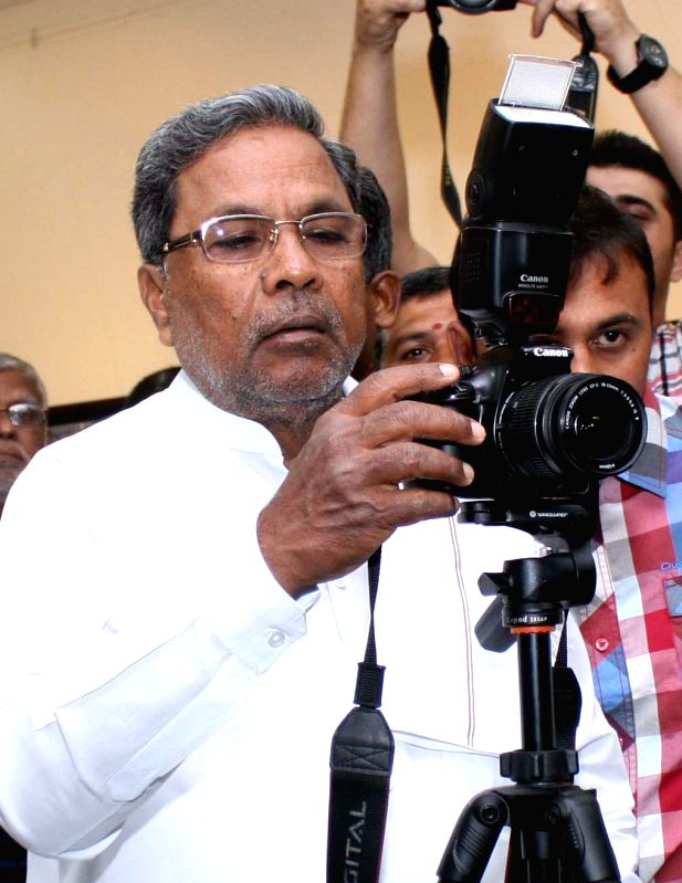 Karnataka Chief Minister Siddaramaiah during the inauguration of `Frozen Memories` a photo exhibition organised by the Photojournalist Association of Bangalore in Bengaluru on April 27, ... - Siddaramaiah