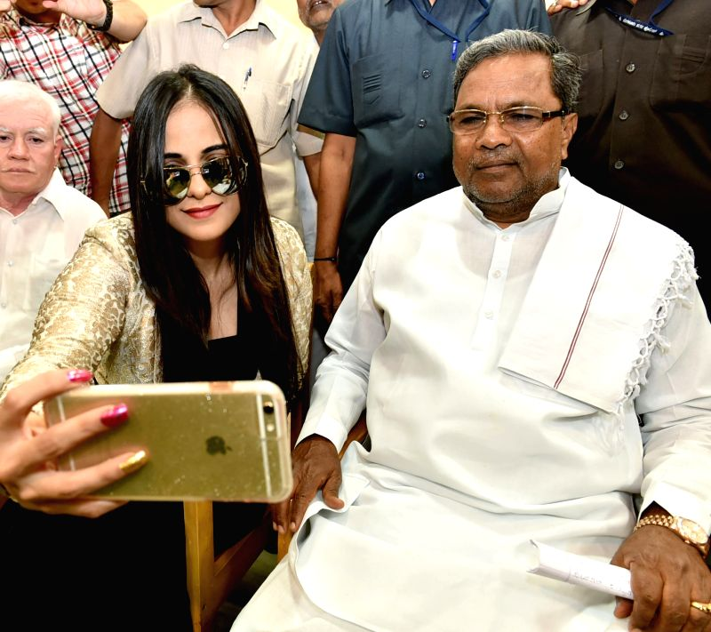 Karnataka Chief Minister Siddaramaiah and actress Jennifer Kotwal during the inauguration of `Frozen Memories` a photo exhibition organised by the Photojournalist Association of Bangalore ... - Siddaramaiah