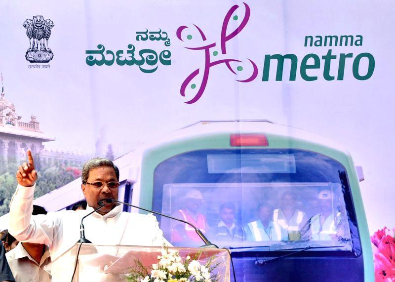 Karnataka Chief Minister Siddaramaiah addresses at the inaugural function of the Namma Metro Line of Reach -3B, at Peenya Industrial Area, in Bangalore on May 1, 2015. - Siddaramaiah