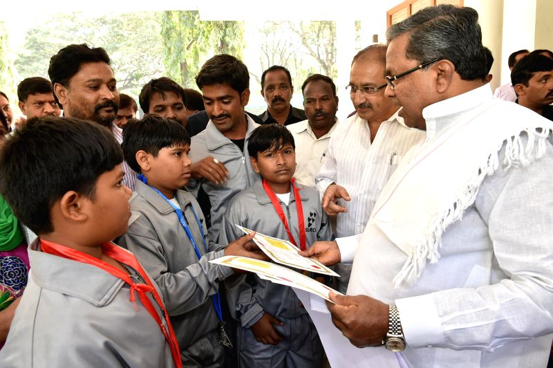 Karnataka Chief Minister Siddramaiah felicitates gold medalists of the 14th International SKA Karate Championship Kiran Yattingudda, Arun Yattingudda, Aditya Sollapur and Coach Danappa ... - Siddramaiah
