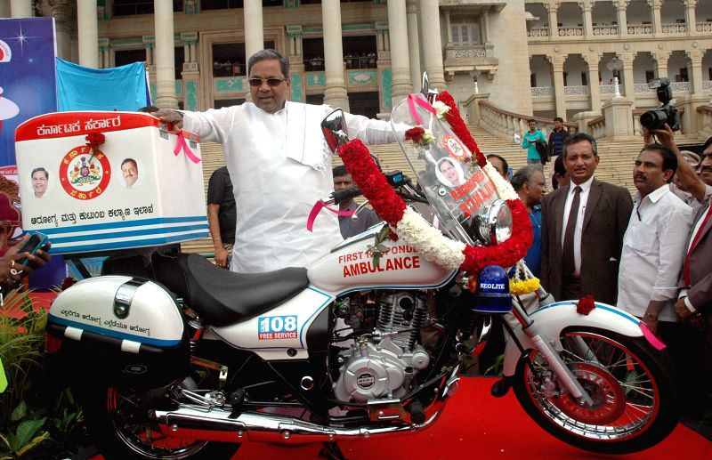 "Karnataka Chief Minster Siddaramaiah at the launch of Bike Ambulance - the first in Asia - as a part of  ""platinum ten minutes"" trauma care initiative aimed to reduce number of ..."