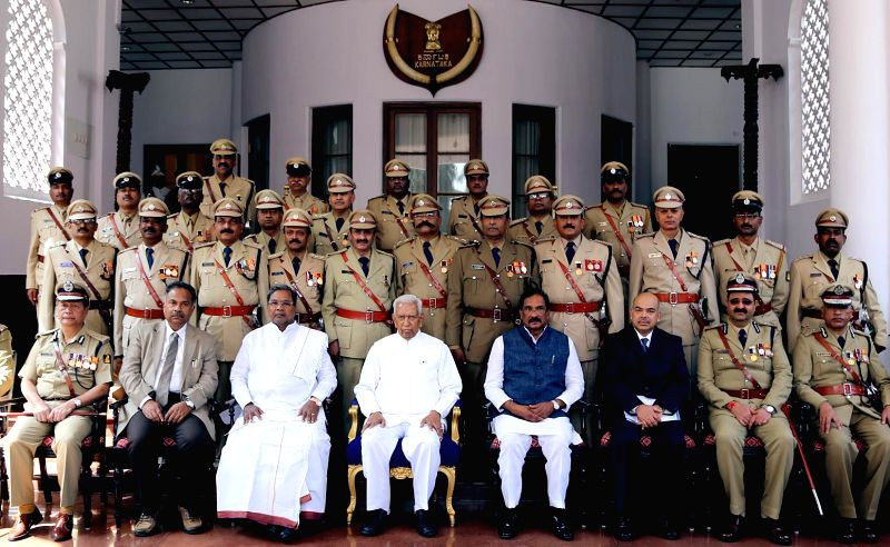 Karnataka Governor Vajubhai Rudabhai Vala, Chief Minister Siddaramaiah and Home Minister KJ George during an investiture ceremony of president's medal recipients at Raj Bhavan in Bengaluru - Siddaramaiah