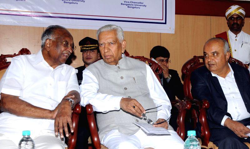 Karnataka Governor Vajubhai Rudabhai Vala with the Chairman of Karnataka Legislative Council D. H. Shankaramurthy, Bangalore University Vice Chancellor Prof. B Thimmegowda and Bangalore ...