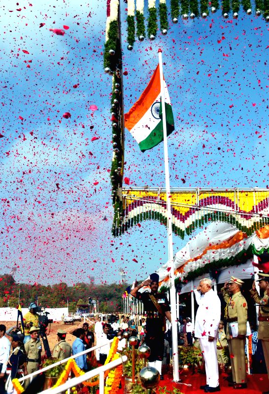Karnataka Governor Vajubhai Rudabhai Vala hoists the national flag at the Manekshaw Parade Grounds on Republic Day  in Bengaluru, on Jan 26, 2015.