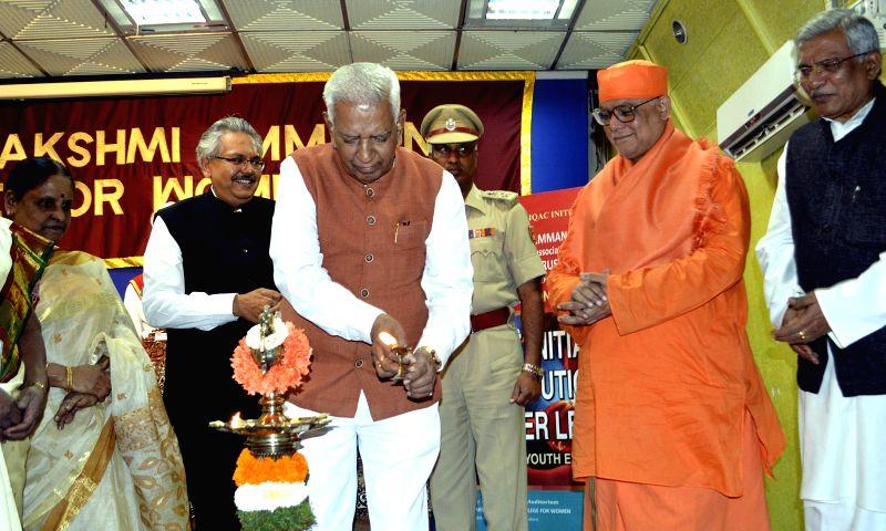 Karnataka Governor Vajubhai Rudabhai Vala with Swami Atmapriyanandaji Maharaj, Vice Chancellor, RKM Vivekananda University, Kolkata, SS Nagananda, Vice Chairman, MLACW Trust, Dr. TL ...