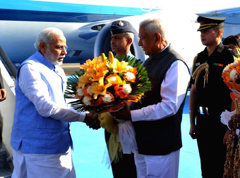 Karnataka Governor Vajubhai Rudabhai Vala receives Prime Minister Narendra Modi on his arrival at Yelahanka Air-force Station, in Bengaluru on Feb 18, 2015. - Narendra Modi